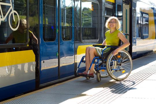 woman sitting on wheelchair on a platform
