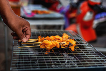 Pictures of grilled squid vendors on the street