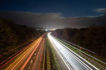 Spoed Foto op Canvas Nacht snelweg Long exposure and light trails of a highway at night