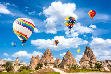 The great tourist attraction of Cappadocia - balloon flight. Cappadocia is known around the world as one of the best places to fly with hot air balloons. Goreme, Cappadocia, Turkey. Travel concept. Ar
