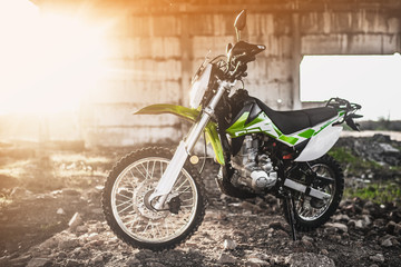 Beautiful green off-road motorcycle Enduro or cross, in a contoured light Fototapete