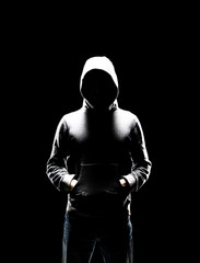 Computer hacker in hoodie. Obscured dark face. Data thief, internet fraud, darknet and cyber...