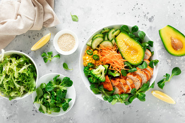 Buddha bowl with grilled chicken breast, avocado and fresh vegetable salad for lunch
