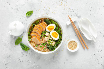 Ramen noodle soup with chicken breast, egg and spinach