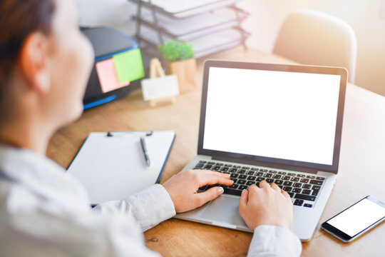 Woman working on laptop in office. Mockup Copyspace Computer or Notebook Concept