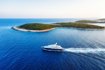 Aerial view on the luxury yacht at the day time. Adventure and travel.  Landscape with ship on Adriatic sea. Luxury cruise. Travel - image