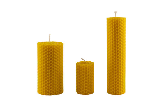 Beeswax candles isolated on white background. Handmade, decorative and healthy candles. Natural aromatic beeswax candle.