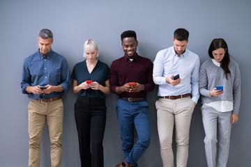 Happy Businesspeople Using Smartphones Wall mural