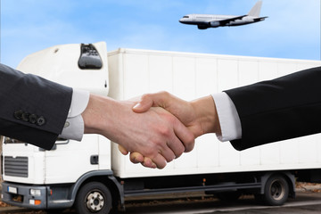 Businessman Shaking Hands In Front Of Mallet