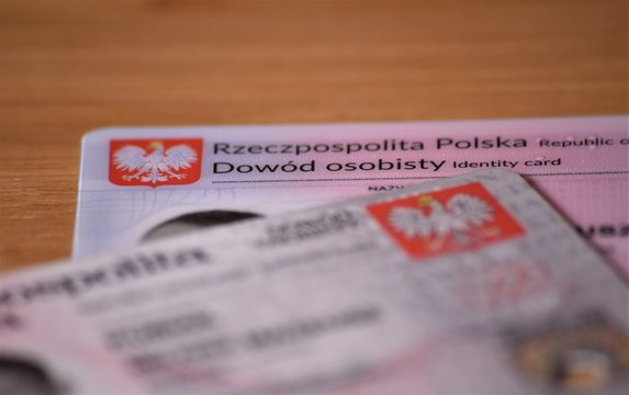 """Polish old ID card and new with chip , translation of description: """"Republic of poland Identity card"""" shallow depth of field."""
