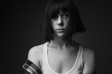 Portrait of crying girl in studio. Black and white.