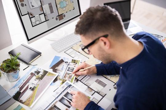Real Estate Designer Working On Computer