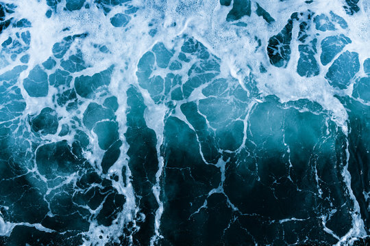 Crashing Waves of sea and Aerial view to ocean wave. Blue water background.