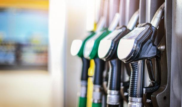 Colorfull fuel gasoline dispenser background. Fuel pumps station close up, copy space.
