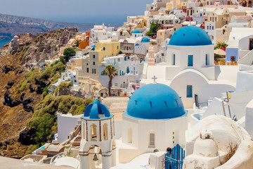 Fototapeten Santorini Famous blue dome orthodox church in village of Oia on Santorini island in Greece in Europe.