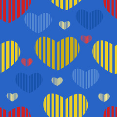 Multicolored hearts seamless pattern on a yellow background