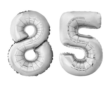 Number 85 eighty five of silver inflatable balloons isolated on white background. Silver chrome helium balloons forming 85 eighty five number
