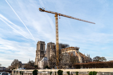 Paris, France: A giant crane for Notre Dame de Paris cathedral reconstruction in January 2020, 7 months after the fire in April 2019.
