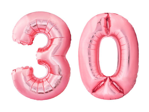 Number 30 thirty made of rose gold inflatable balloons isolated on white background. Pink helium balloons forming 30 thirty number. Discount and sale or birthday concept