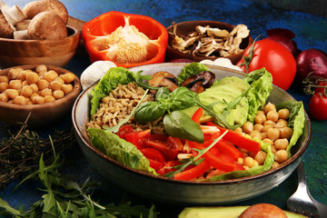 Papiers peints Buddha Quinoa and spicy chickpea vegetable vegetarian buddha bowl. Healthy food concept with tomato