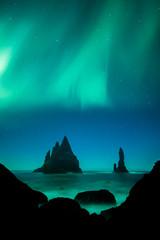Fototapete - Aurora Borealis (Northern Lights) above Vik rock formation, Iceland