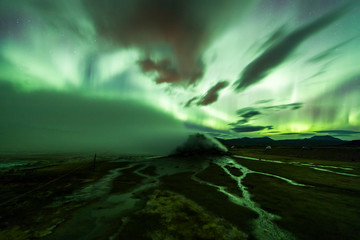 Wall Mural - Aurora Borealis (Northern Lights) above geothermal volcanic vents in Hveravellir