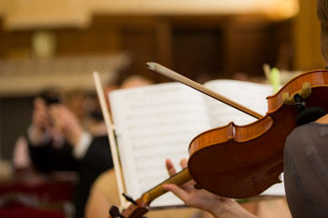 Violinist playing at a wedding orchestra in church