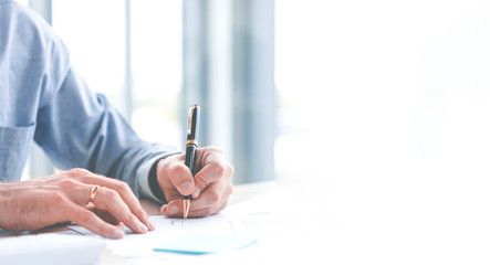 Close up of hand Caucasian young businessman signing a contract. About the financial business in the office. Panoramic web banner on white background with copy space concept.