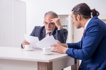 Two businessman discussing business in office