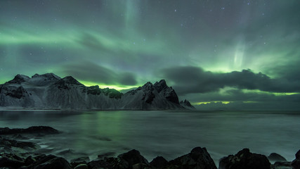 Wall Murals Green coral Aurora Borealis (Northern Lights) above Stokksnes Beach and Vestrahorn Mountains, Iceland