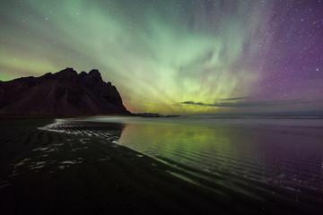 Acrylic Prints Olive Aurora Borealis (Northern Lights) above Stokksnes Beach and Vestrahorn Mountains, Iceland