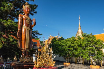 Wooden standing buddha at Wat Phra That Doi Suthep templ in Chiang Mai, Thailand