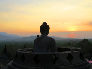 Stupa buddha at sunset at the Borobudur temple