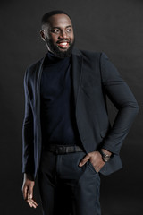 Stylish African-American man on dark background