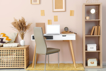 Stylish comfortable workplace with laptop in modern room Wall mural