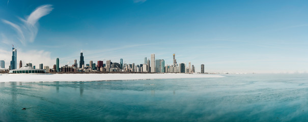Chicago downtown skyline panorama, winter scenery with frozen lake