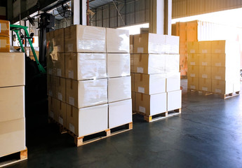 Interior of warehouse with stack package boxes on pallets, Warehouse industry delivery shipment goods, Logistics and transport Wall mural