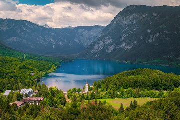 Wall Mural - Traditional alpine church on the Bohinj lake shore, Slovenia