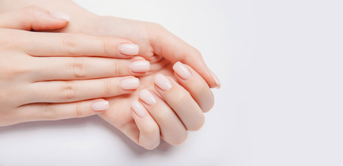 Fototapeten Maniküre Stylish trendy nail young woman hands pink manicure on white background