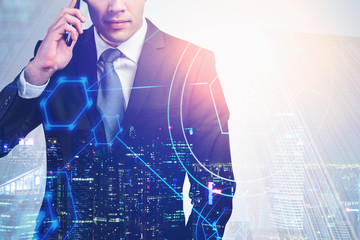 Fotobehang - Businessman on phone in city, network