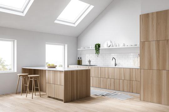 Attic white kitchen corner with bar