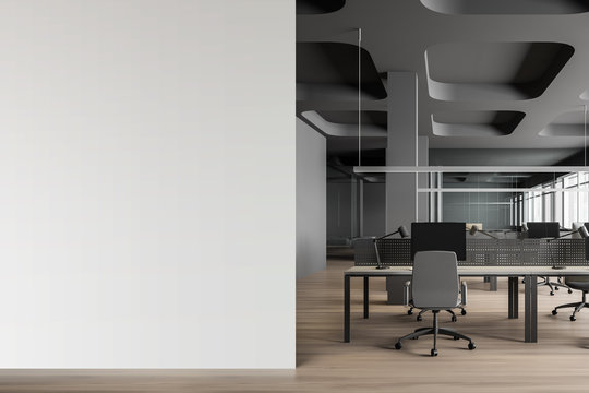 Gray open space office interior with mock up wall