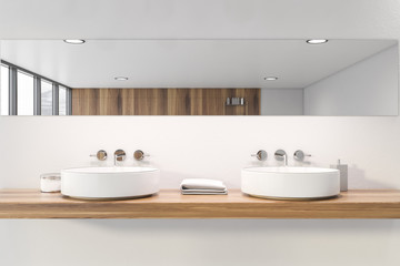 Double sink in white bathroom