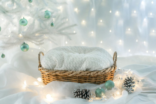 basket for baby decorated with  christmas tree and snow