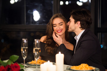 Happy man and woman enjoying Valentine's Day date