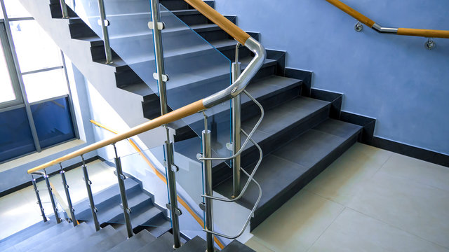 Stainless steel, glass and wood railing.Fall Protection. modern design of handrail and staircase