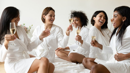 Türaufkleber Spa Smiling girls have fun drink champagne at hen party