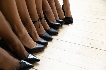 Close up of diverse ladies black shoes at bridal shower