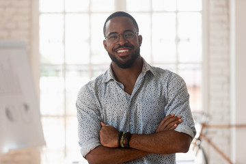 Portrait of smiling african American businessman posing in office