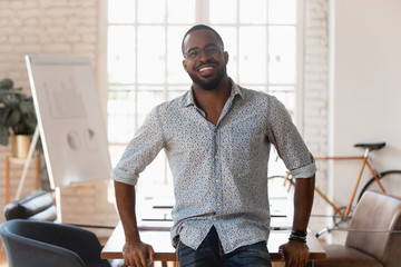 Portrait of smiling african American employee posing in office
